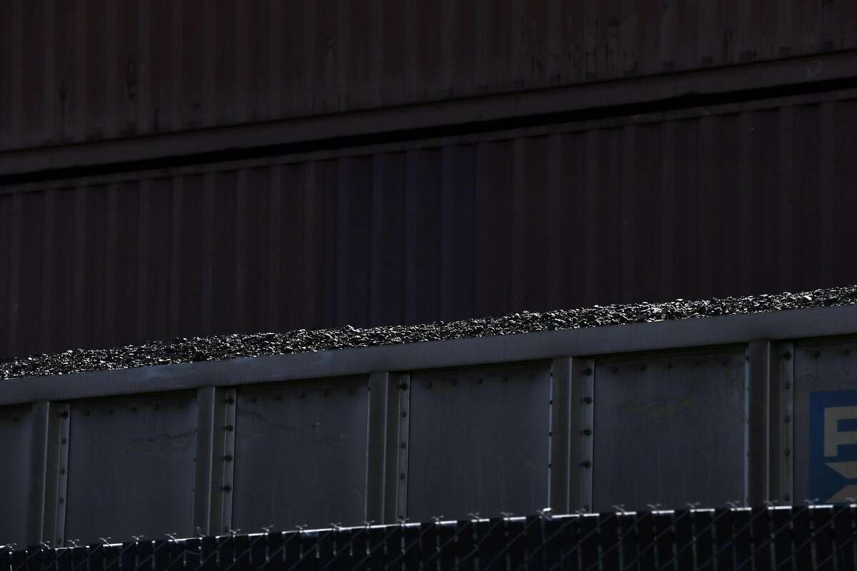 Coal sits in an uncovered train car at the Levin-Richmond Terminal in Richmond, Calif., on Thursday, July 23, 2015. A similar plan for a coal exporting operation has been proposed at the old Oakland Army Base by Oakland developer Phil Tagami and a company called Terminal Logistics Solutions.