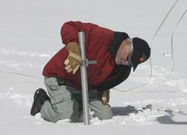Frank Gehrke, chief of the California Cooperative Snow Surveys Program for the Department of Water Resources, checks the snowpack depth while performing the snow survey at Phillips Station near Echo Summit, Calif., Wednesday, March 30, 2016. The survey showed the snowpack at about 95 percent of normal for this site at this time of year. (AP Photo/Rich Pedroncelli)