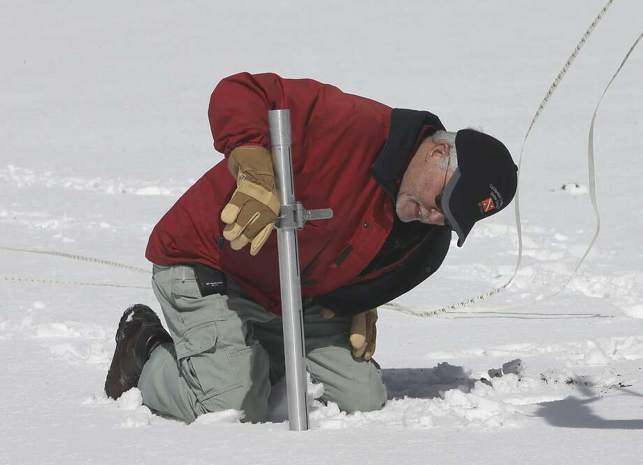 Frank Gehrke, chief of the California Cooperative Snow Surveys Program for the Department of Water Resources, checks the snowpack depth while performing the snow survey at Phillips Station near Echo Summit, Calif., Wednesday, March 30, 2016. The survey showed the snowpack at about 95 percent of normal for this site at this time of year. (AP Photo/Rich Pedroncelli) Photo: Rich Pedroncelli, AP