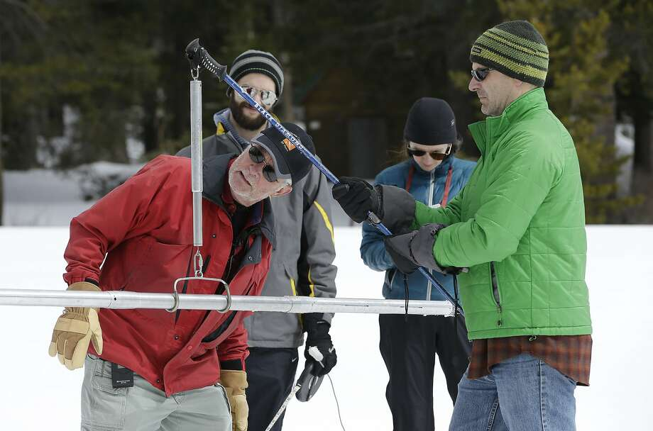 Frank Gehrke, chief of the California Cooperative Snow Surveys Program for the Department of Water Resources, checks the weight of the snowpack, on a scale held by Dan Brumbaugh, right, as he performs the snow survey at Phillips Station, Wednesday, March 30, 2016, in Echo Summit, Calif. Photo: Rich Pedroncelli, AP
