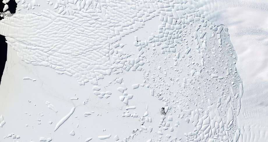 This satellite image provided by Nature/Knut Christianson, taken Jan. 9, 2016, shows the Thwaites Glacier and its ice cliff at the terminus of Thwaites Glacier, West Antarctica. A new study points says ice cliffs may lead to faster melting of Antarctic ice sheets and more sea level rise than previously thought with the Thwaites Glacier and its ice cliffs as the most likely place for this process to start. (Knut Christianson/Nature via AP)