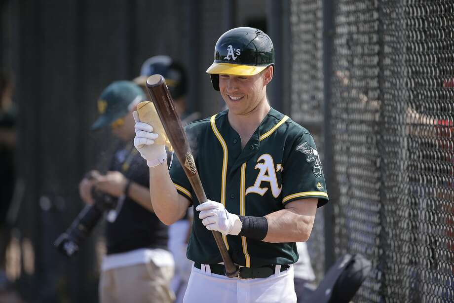 Chris Coghlan is among the new faces who will try to carry the A's to a bounce-back year after a 94-loss season. Photo: Michael Macor, The Chronicle