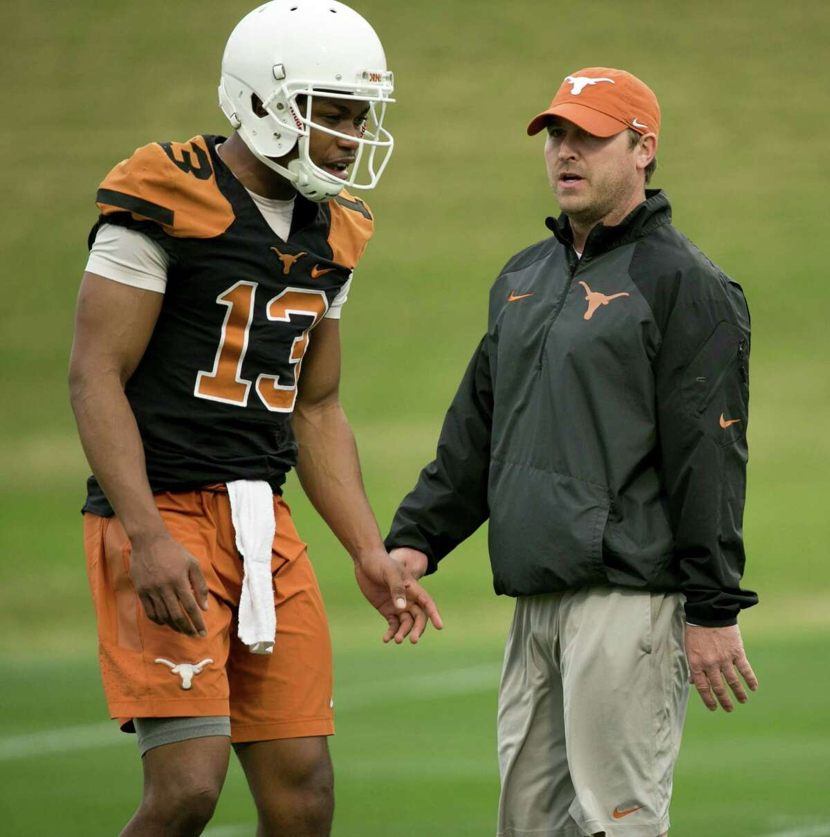 UT offensive coordinator Sterlin Gilbert talks to quarterback Jerrod Heard during the first spring practice at Denius Fields on March 7, 2016, in Austin