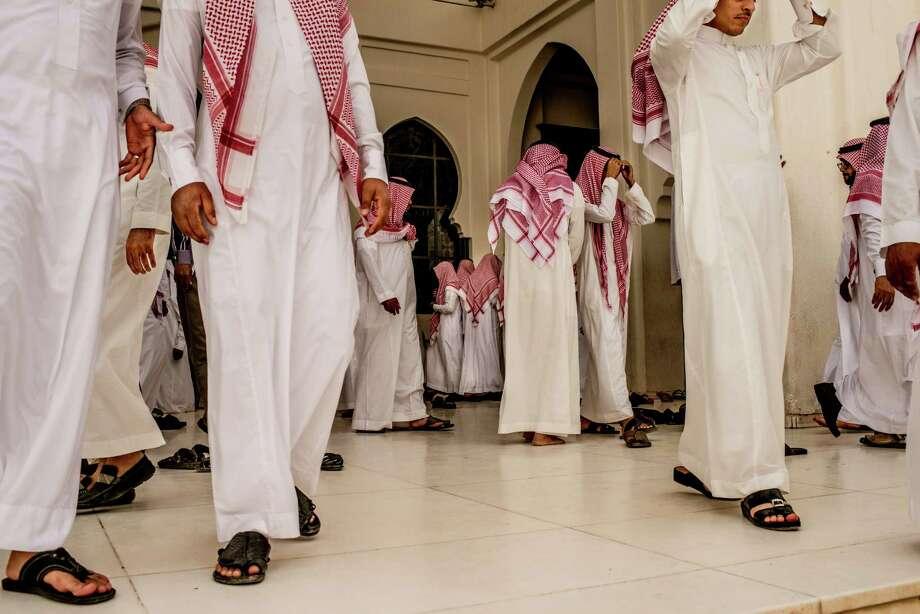 Men leave a mosque after prayers in Riyadh, Saudi Arabia. (Tomas Munita/The New York Times) Photo: TOMAS MUNITA, STR / NYTNS