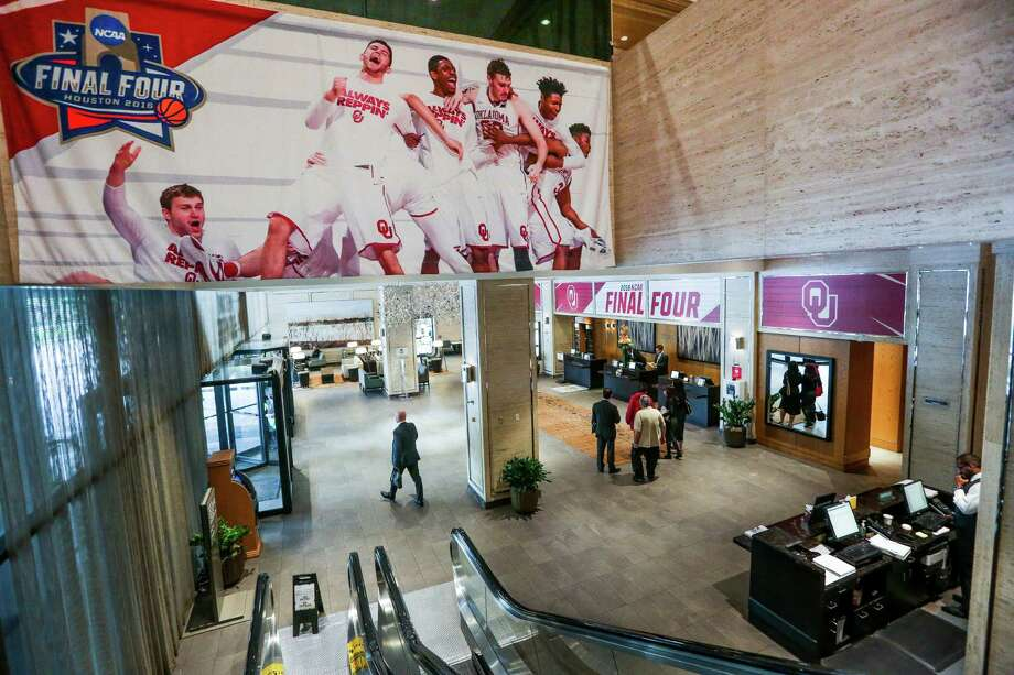 People walk through the hotel lobby of the Westin Galleria, the official NCAA hotel for the Oklahoma Sooners basketball team, as they prepare for the Final Four team to arrive Wednesday, March 30, 2016 in Houston. Photo: Michael Ciaglo, Houston Chronicle / © 2016  Houston Chronicle