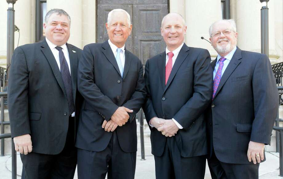 From left, Daniel Morris, President of The Rotary Club of Stamford, H. Darrell Harvey, co-chairman of Stamford Hospital Foundation, Brian Grissler, President/CEO of Stamford Hospital and Rev. David Van Dyke, pastor at The First Presbyterian Church of Stamford, are photographed prior to an announcement that their each of their organizations would share part of a $100 million charitable trust gifted by the Gilllespie Estate in a ceremony in Stamford on March 30, 2016. Photo: Matthew Brown / Hearst Connecticut Media / Stamford Advocate