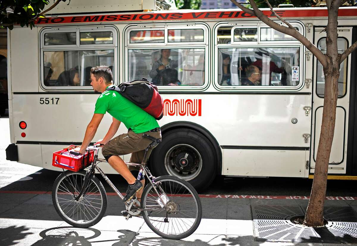 Jeff Dunst, a deliveryman for Postmates, delivers donuts to his clients on Tuesday, Aug 7, 2012 in San Francisco.