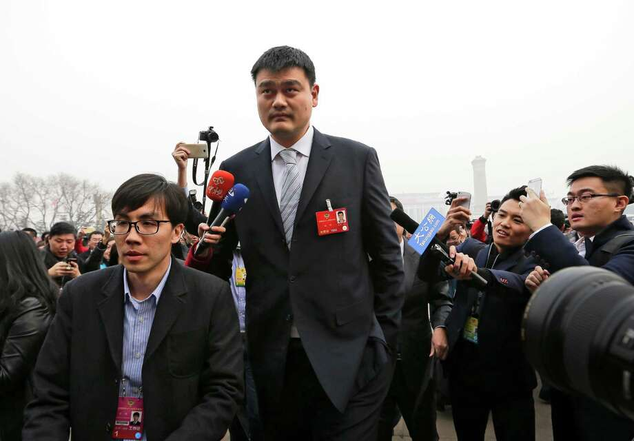 China's former basketball player and CPPCC representative Yao Ming, center, is chased by journalists as he arrives at the Great Hall of the People to attend the opening session of the Chinese People's Political Consultative Conference (CPPCC) in Beijing, Thursday, March 3, 2016. The more than 2,000 members of China's top legislative advisory body convened their annual meeting Thursday, kicking off a political high season that will continue with the opening of the national congress on Saturday. (AP Photo/Andy Wong) Photo: Andy Wong, STF / AP