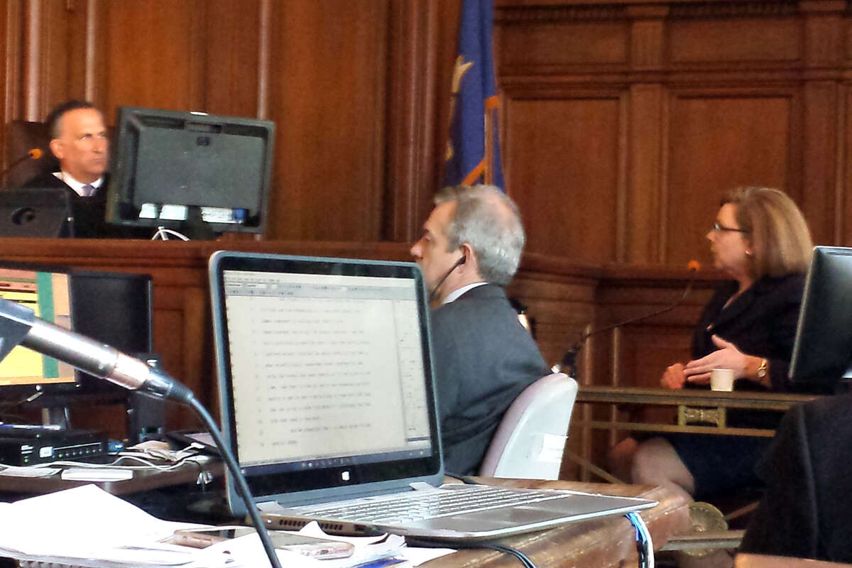 Education Commissioner Dianna Wentzell, seated right, testifies at the Connecticut Coalition for Justice in Education Funding trial in Hartford, Conn. March 30, 2016.