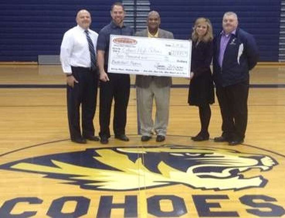 "On March 14, Wendell Williams, president of the Board of the Cohoes Connect Center for Youth, presented a check for $2,000 to the Cohoes School District's basketball program. As a community partner with the Cohoes School District and basketball programs, the Connect Center for Youth, whose mission is to ""Encourage, Inspire and Empower Youth,"" designated these funds to be paid forward from its Fall Fundraiser.  From left, Joe Rajczak, Cohoes High School principal; Coach Jeff Huneau, varisty basketball; Wendell Williams, president of the Board Connect Center for Youth; Superintendent Jennifer Spring and city Alderman Bill Smith. (Submitted photo)"