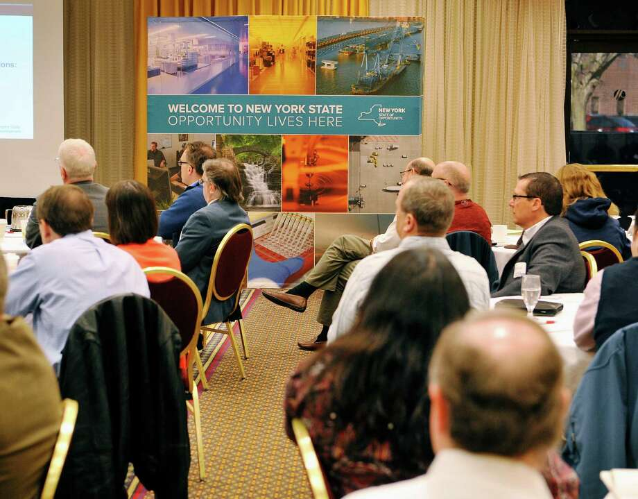Attendees listen as Erin Cole, senior vice president for Global NY at Empire State Development Corporation, talks about the Global NY initiative during an event on Wednesday, March 30, 2016, at the Albany Marriott in Albany, N.Y.  (Paul Buckowski / Times Union) Photo: PAUL BUCKOWSKI / 10036025A