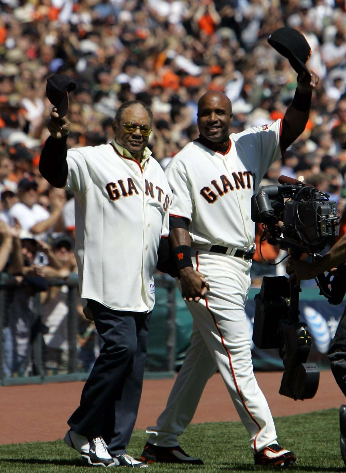 San Francisco Giants' Barry Bonds walks out with his godfather and fellow Giants All-Star Willie Mays, left, on opening day during their baseball game against the San Diego Padres in San Francisco, in this April 3, 2007 file photo. In preparation for this year's All-Star game to be held at AT&T Park, the team honored Giants who have represented the team as an All-Star.