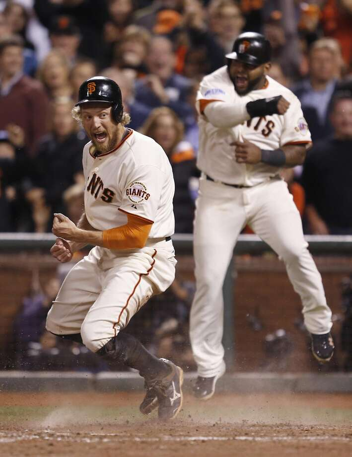 Pablo Sandoval and Hunter Pence celebrate their eighth-inning score off aJuan Perez triple during Game 5 of the 2014 World Series at AT&T Park. Photo: Scott Strazzante, The Chronicle