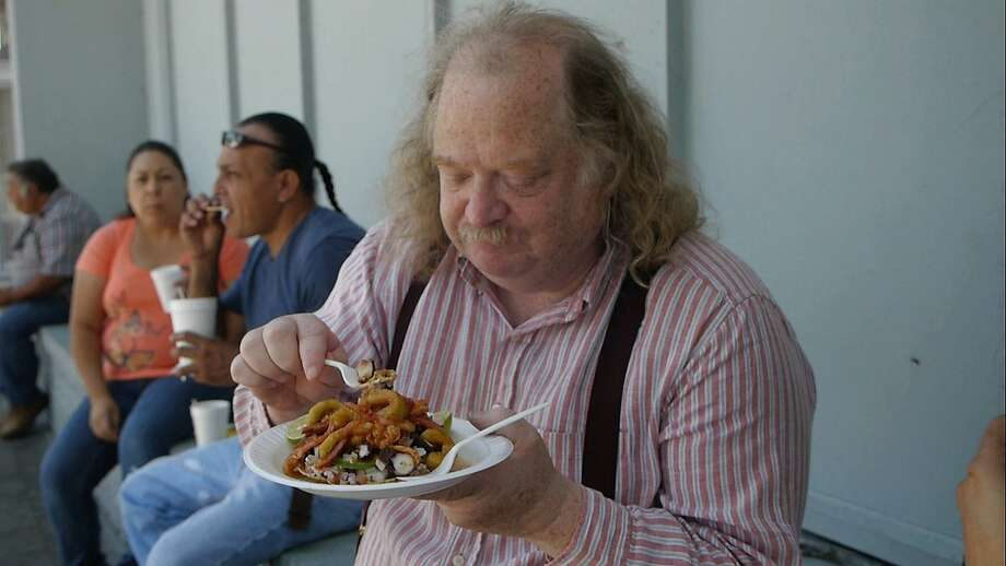 """Food critic Jonathan Gold eating in the documentary """"City of Gold."""""""