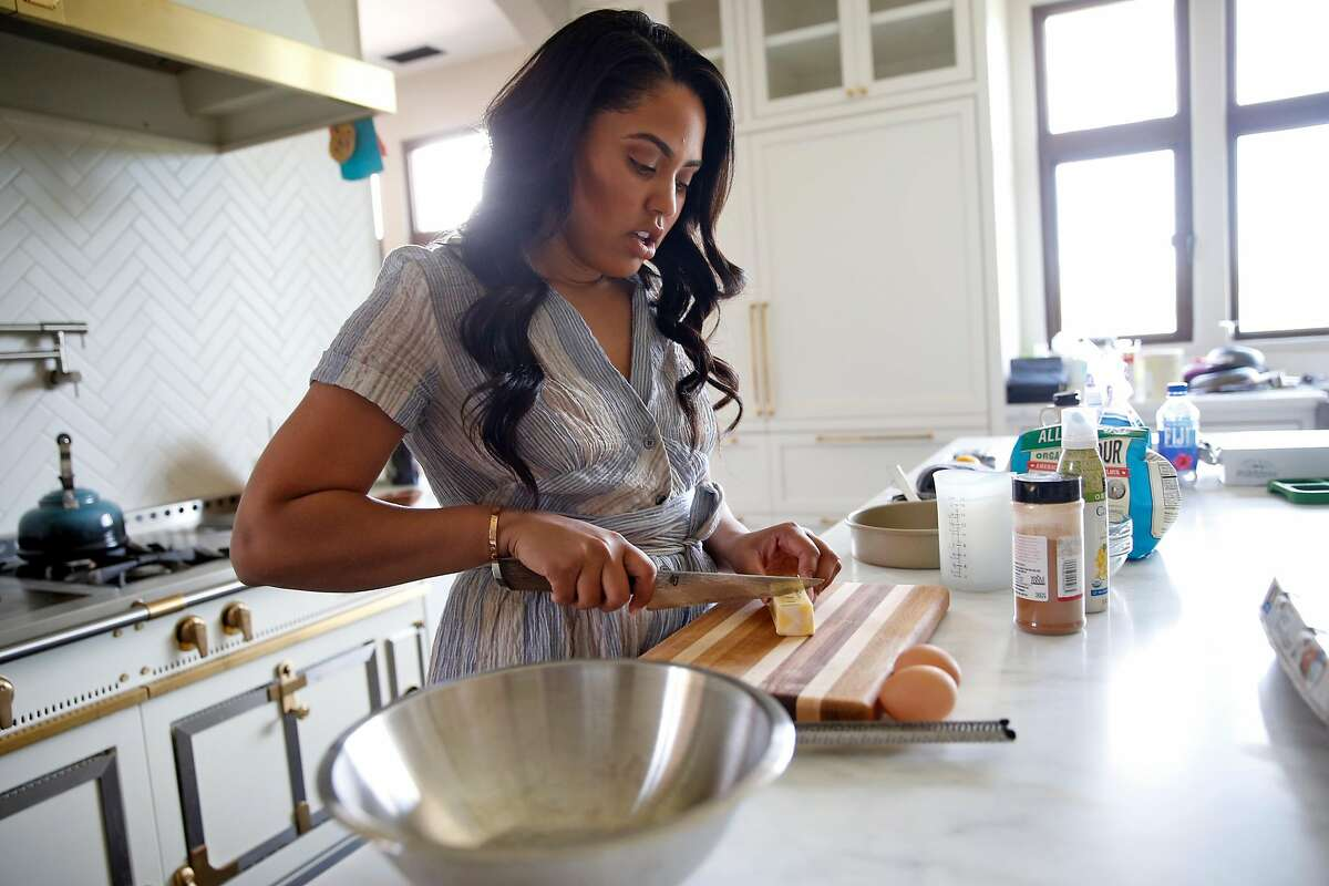 """Ayesha Curry prepares for the taping of her CSN Bay Area show """"Cookin' with the Currys"""" in the kitchen of her home in Walnut Creek, Calif., on Wednesday, March 30, 2016."""