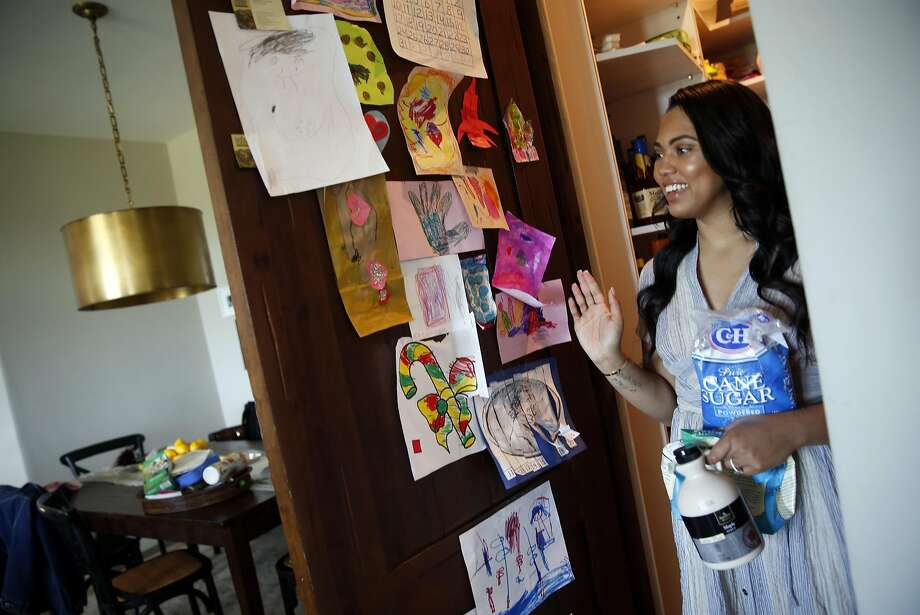 Left: Curry walks past the art gallery of works created by 3-year-old daughter Riley, who has gotten a fair amount of camera time herself. Photo: Scott Strazzante, The Chronicle