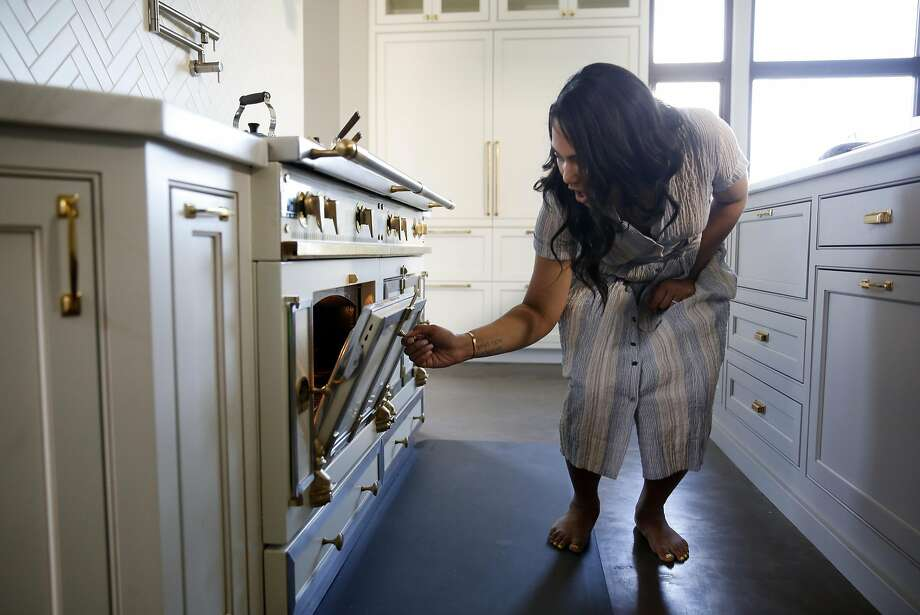 Dirty dishes go in the oven Photo: Scott Strazzante, The Chronicle