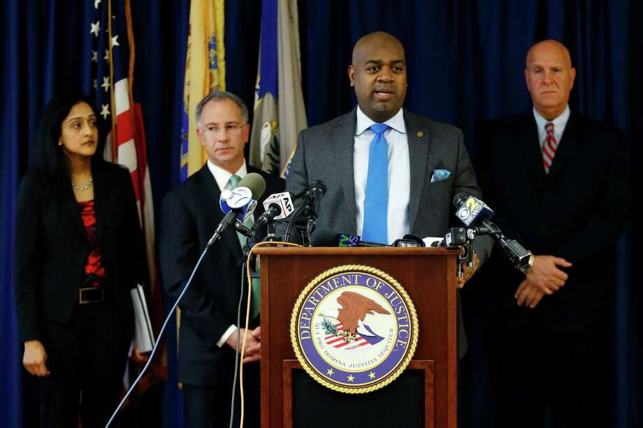 Newark Mayor Ras Baraka, front, stands with Vanita Gupta, left, principal deputy assistant attorney general for the U.S. Department of Justice Civil Rights Division, Paul Fishman, second from left, U.S. attorney for the District of New Jersey, and Anthony Ambrose, right, Newark public safety director, while speaking during a news conference, Wednesday, March 30, 2016, in Newark, N.J.  Newark Mayor Ras Baraka speaks during a news conference Wednesday, March 30, 2016, in Newark, N.J.  The federal government and Newark announced a settlement Wednesday to reform the city's police department after allegations that officers have engaged in a pattern of making unconstitutional stops and arrests that have had a disparate impact on minorities. (AP Photo/Julio Cortez) Photo: Julio Cortez, STF