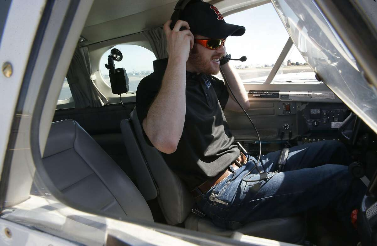 One of two pilot Brandon Thurston at the municipal airport in Modesto, California, on Wed. March 30, 2016, in the cockpit of the specially equipped airplane they fly over the Sierra foothills to load clouds with silver iodide so they produce more precipitation.