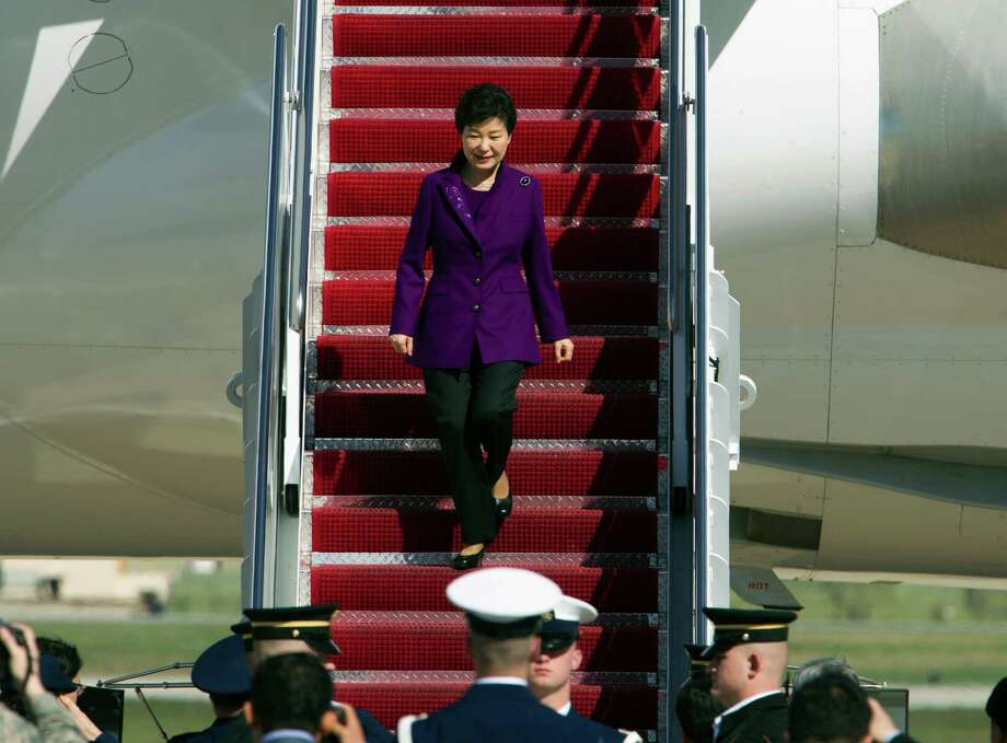 South Korean President Park Geun-hye walks down the stairs from a plane upon her arrival at Andrews Air Force Base, Md., Wednesday, March 30, 2016. Park is in Washington to attend the Nuclear Security Summit.  (AP Photo/Jose Luis Magana) ORG XMIT: MDJL111 Photo: Jose Luis Magana / FR159526 AP