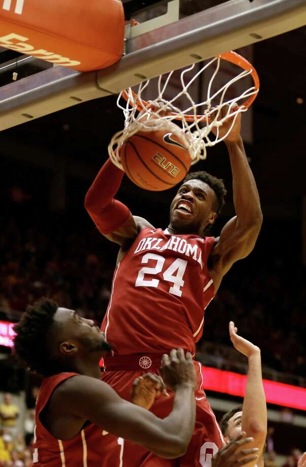 FILE - In this Jan. 18, 2016, file photo, Oklahoma guard Buddy Hield (24) dunks the ball during the first half of a college basketball game against Iowa State in Ames, Iowa. Buddy Hield had big expectations when he returned to Oklahoma for his senior season. Things have gone even better than expected. The sharpshooting guard has averaged 29.3 points in the NCAA Tournament heading into the Sooners' national semifinal Saturday against Villanova. (AP Photo/Charlie Neibergall, File) ORG XMIT: NY165 Photo: Charlie Neibergall / AP