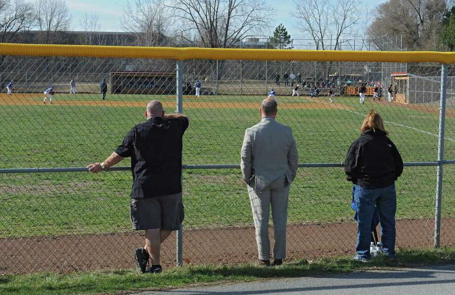 Parents watch a scrimmage baseball game between Queensbury and Colonie on Wednesday, March 30, 2016 in Colonie, N.Y. The nice weather has allowed spring teams to get outdoors much earlier than usual. (Lori Van Buren / Times Union) Photo: Lori Van Buren / 10036027A