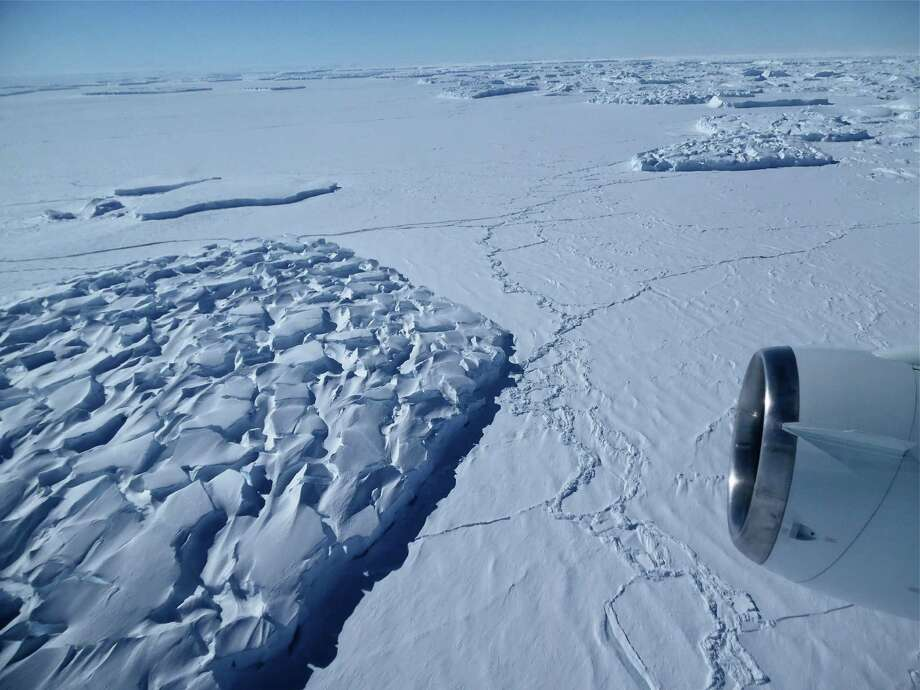 Large icebergs that have broken from the side of  a glacier in Antarctica are seen from a NASA aircraft. Photo: JIM YUNGEL, HO / NASA