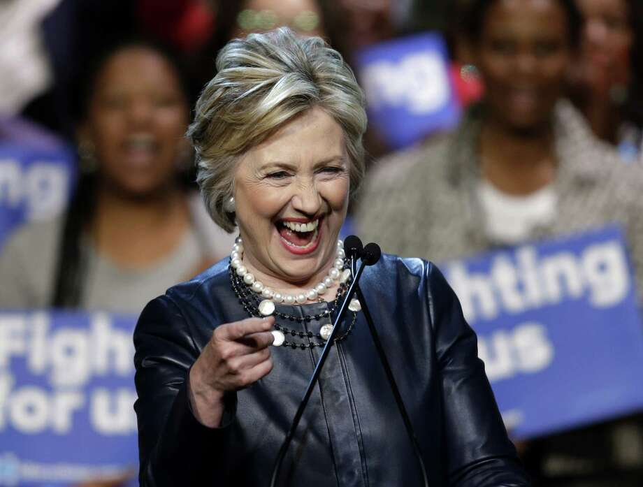 Democratic presidential candidate Hillary Clinton laughs during a rally at the Apollo Theater in New York, Wednesday, March 30, 2016. (AP Photo/Seth Wenig) ORG XMIT: NYSW104 Photo: Seth Wenig / AP