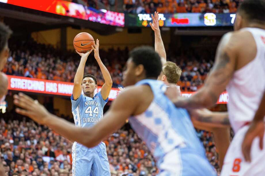 North Carolina's Justin Jackson, left, has come a long way since playing basketball in his driveway in the snow and later competing for the Homeschool Christian Youth Association Warriors. Photo: Brett Carlsen, Stringer / 2016 Getty Images