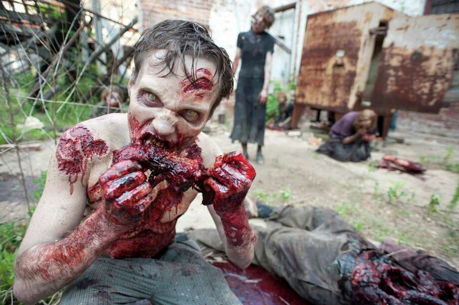 """The Walking Dead"" on AMC doesn't shy away from gore as zombies feast on humans. Photo: Gene Page, Handout / ONLINE_YES"