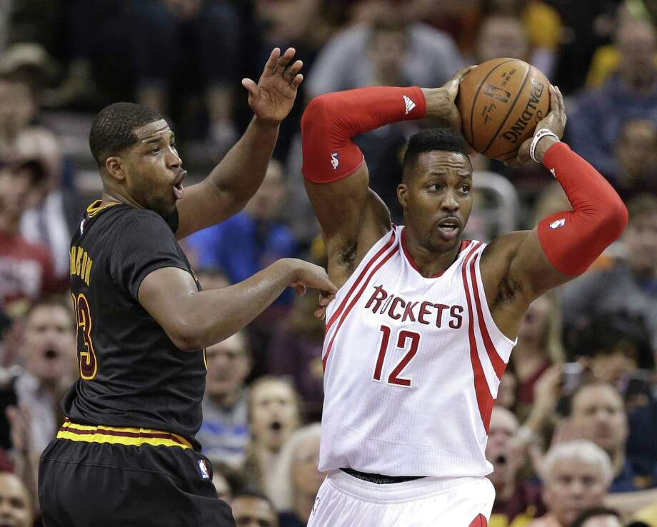 Houston Rockets' Dwight Howard (12) looks to pass against Cleveland Cavaliers' Tristan Thompson (13) in the first half of an NBA basketball game Tuesday, March 29, 2016, in Cleveland. (AP Photo/Tony Dejak) Photo: Tony Dejak, STF / AP