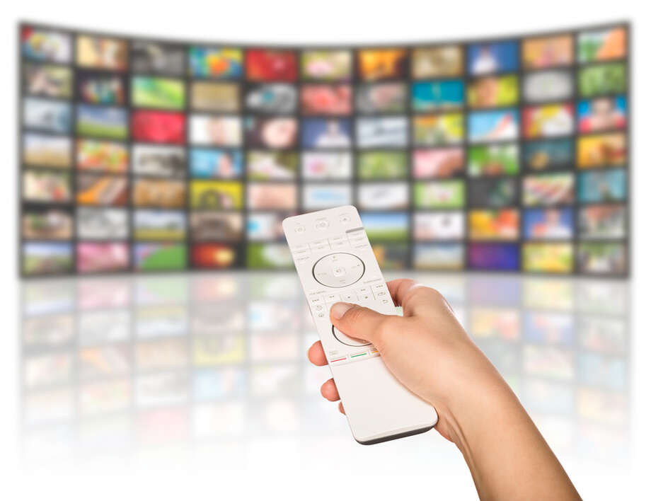LCD TV panels. Television production technology concept. Remote control. / Artur Marciniec - Fotolia