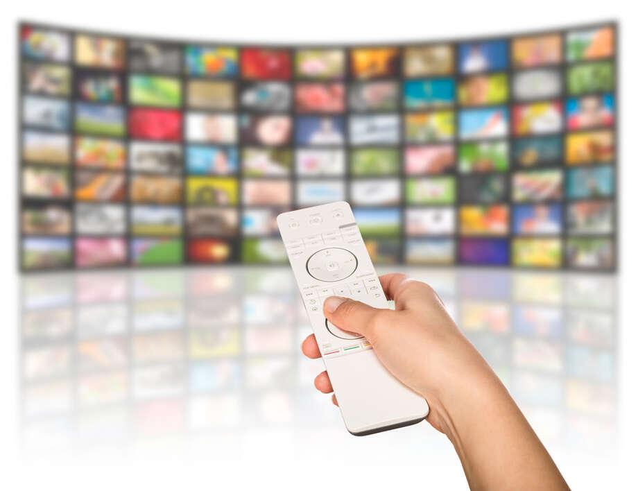 LCD TV panels. Television production technology concept. Remote control. / Artur Marciniec - Fotolia