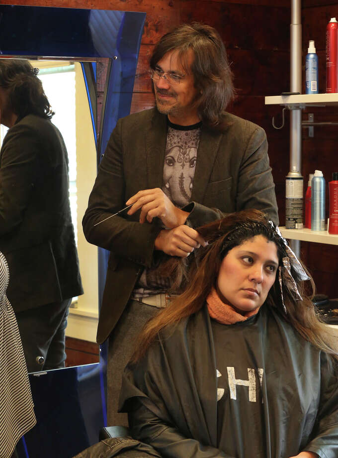 Andrew Guerra, owner of the Ritz Hair Studio, styling hair. The salon is a subject of controversy in the Mahncke Park neighborhood just north of downtown after Guerra spent thousands of dollars renovating the structure for his business. Photo: John Davenport /San Antonio Express-News / ©San Antonio Express-News/John Davenport
