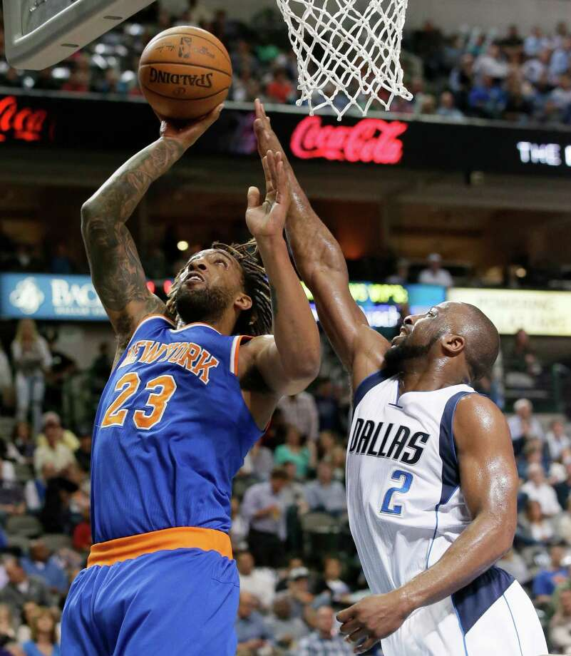 New York Knicks forward Derrick Williams (23) shoots against Dallas Mavericks guard Raymond Felton (2) during the first half of an NBA basketball game Wednesday, March 30, 2016, in Dallas. (AP Photo/LM Otero)   ORG XMIT: DNA109 Photo: LM Otero / AP