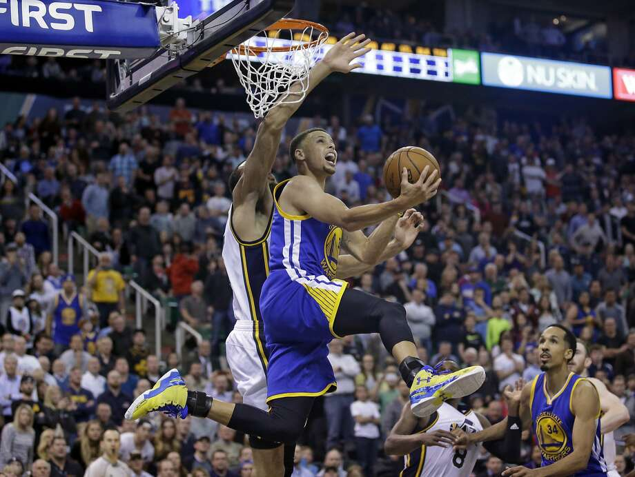 Golden State Warriors guard Stephen Curry (30) lays the ball up as Utah Jazz center Rudy Gobert, rear, defends during the second half of an NBA basketball game Wednesday, March 30, 2016, in Salt Lake City. The Warriors won 103-96 in overtime. (AP Photo/Rick Bowmer) Photo: Rick Bowmer, AP