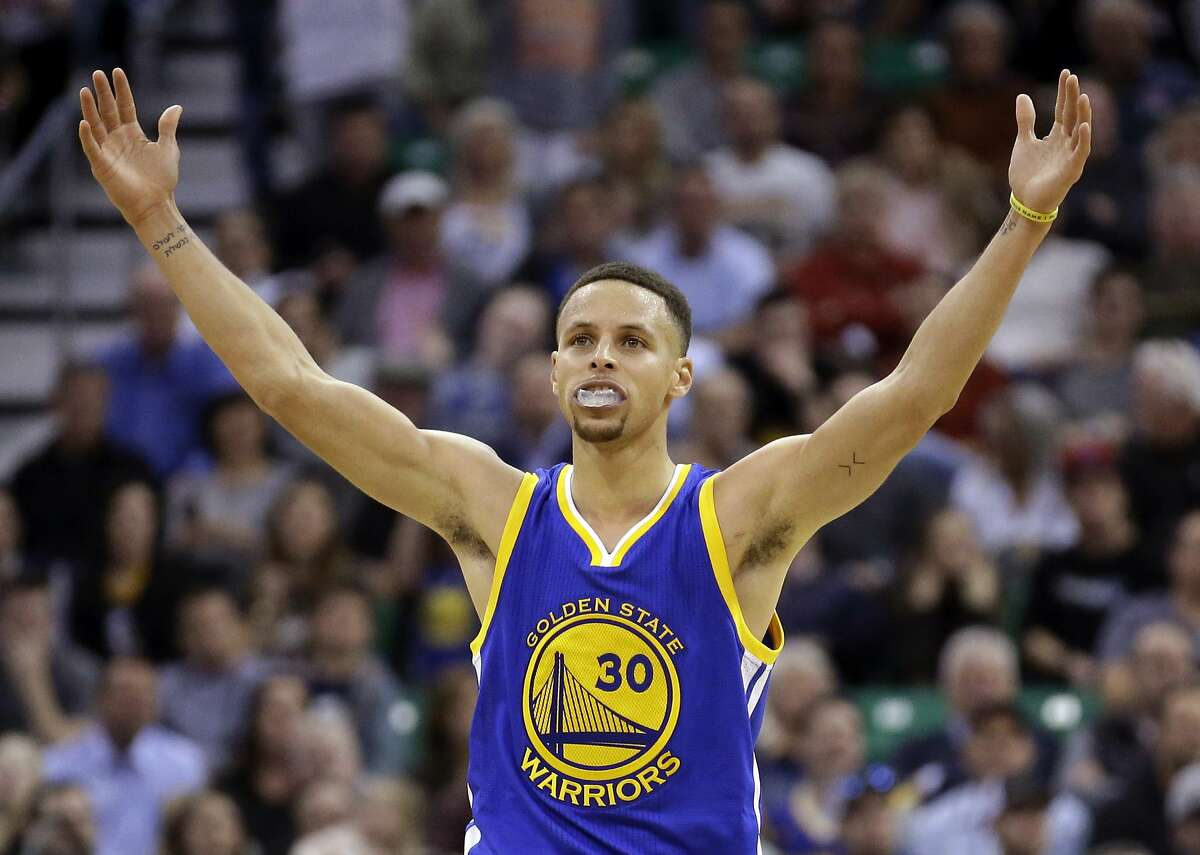 Golden State Warriors guard Stephen Currycelebrates during overtime in the team's NBA basketball game against the Utah Jazz on Wednesday, March 30, 2016, in Salt Lake City. The Warriors won 103-96. (AP Photo/Rick Bowmer)
