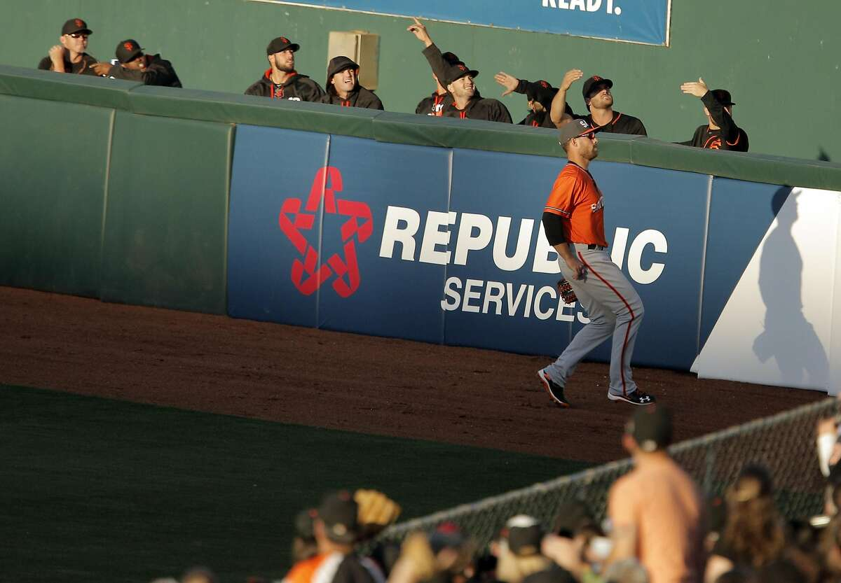The Giants bullpen watches along with Mac Williamson (7) as a Brandon Crawford homerun goes over the fence as the San Francisco Giants played the Sacramento River Cats at Raley Field in Sacramento, Calif., on Wednesday, March 30, 2016.