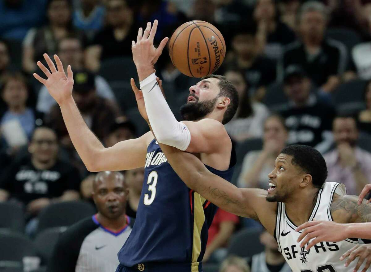 New Orleans Pelicans forward Nikola Mirotic (3) is fouled by San Antonio Spurs forward Rudy Gay as they scramble for a rebound during the first half of an NBA basketball game Wednesday, Feb. 28, 2018, in San Antonio. (AP Photo/Eric Gay)