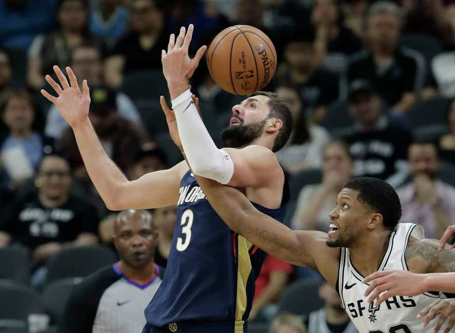 New Orleans Pelicans forward Nikola Mirotic (3) is fouled by San Antonio Spurs forward Rudy Gay as they scramble for a rebound during the first half of an NBA basketball game Wednesday, Feb. 28, 2018, in San Antonio. (AP Photo/Eric Gay) Photo: Eric Gay, Associated Press / Copyright 2018 The Associated Press. All rights reserved.
