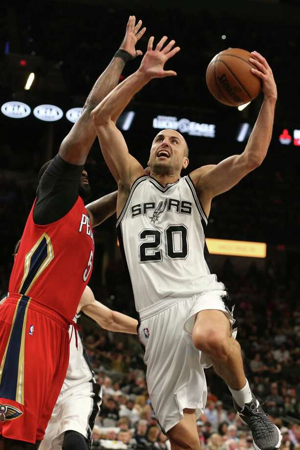 San Antonio Spurs' Manu Ginobili shoots over New Orleans Pelicans' Kendrick Perkins during the first half at the AT&T Center, Wednesday, March 30, 2016. Photo: JERRY LARA, San Antonio Express-News / © 2016 San Antonio Express-News