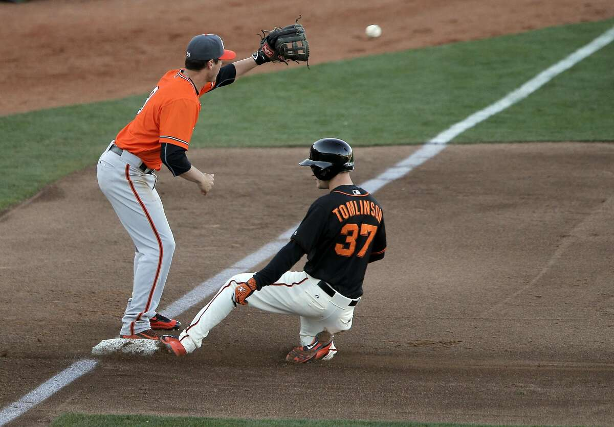 Kelby Tomlinson reaches third in the third inning as the San Francisco Giants played the Sacramento River Cats at Raley Field in Sacramento, Calif., on Wednesday, March 30, 2016.