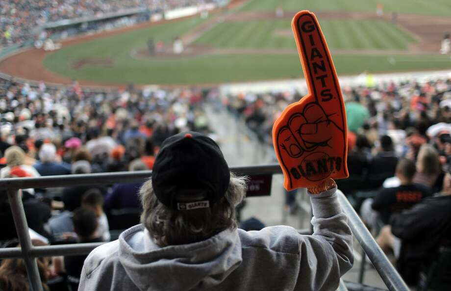 Cathy Thonis of Carmichael waves her foam Giants finger as the San Francisco Giants played the Sacramento River Cats at Raley Field in Sacramento, Calif., on Wednesday, March 30, 2016. Photo: Carlos Avila Gonzalez, The Chronicle