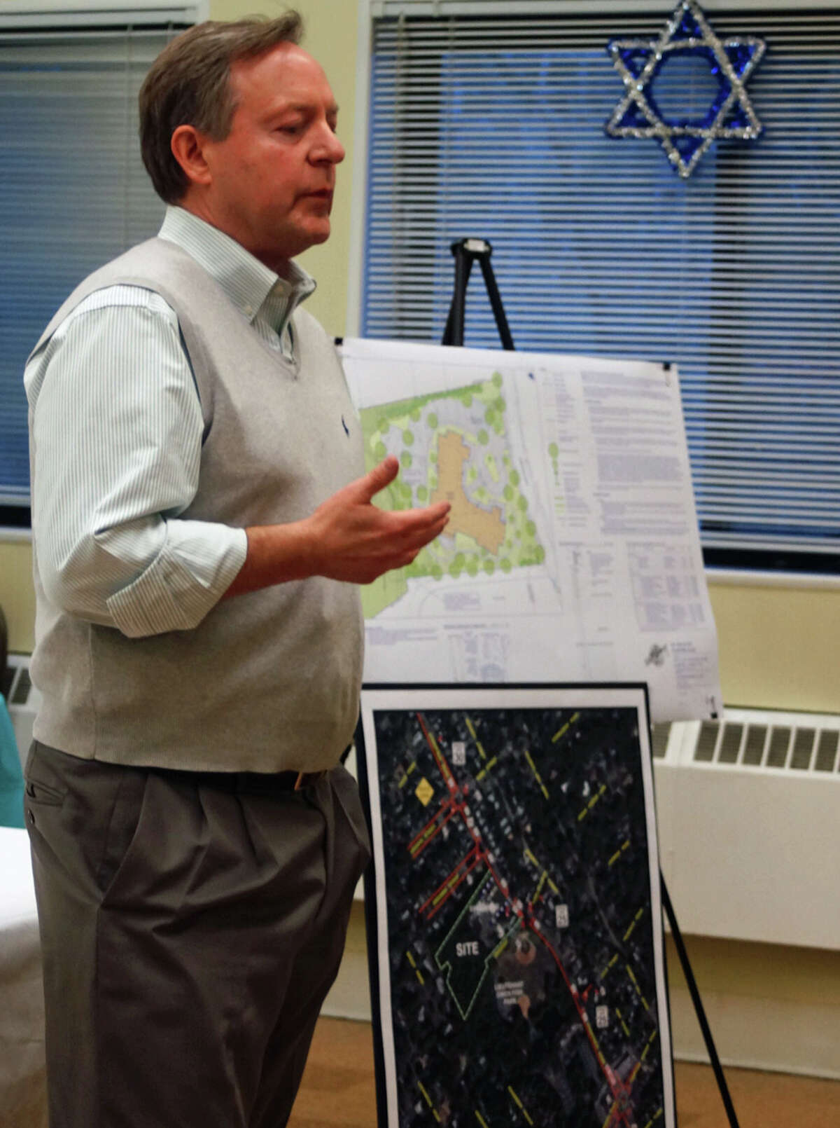 Mark DePecol, CEO of Senior Living Development, outlines plans for a proposed assisted living facility on Stratfield Road at a meeting with neighbors.