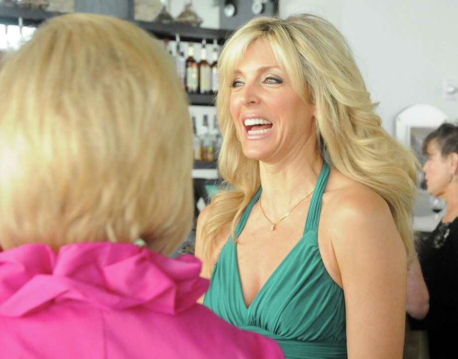 Actress Marla Maples greets guests during the Moonlight Rhapsody, hosted by La Torretta Lake Resort & Spa on Lake Conroe, a charity gala hosted by actress Marla Maples to benefit the Montgomery County Women's Center. The gala consists of a cocktail reception for Maples followed by a four-course dinner at La Torretta's Chez Roux restaurant.  Photo by David Hopper Photo: David Hopper / For The Chronicle / freelance