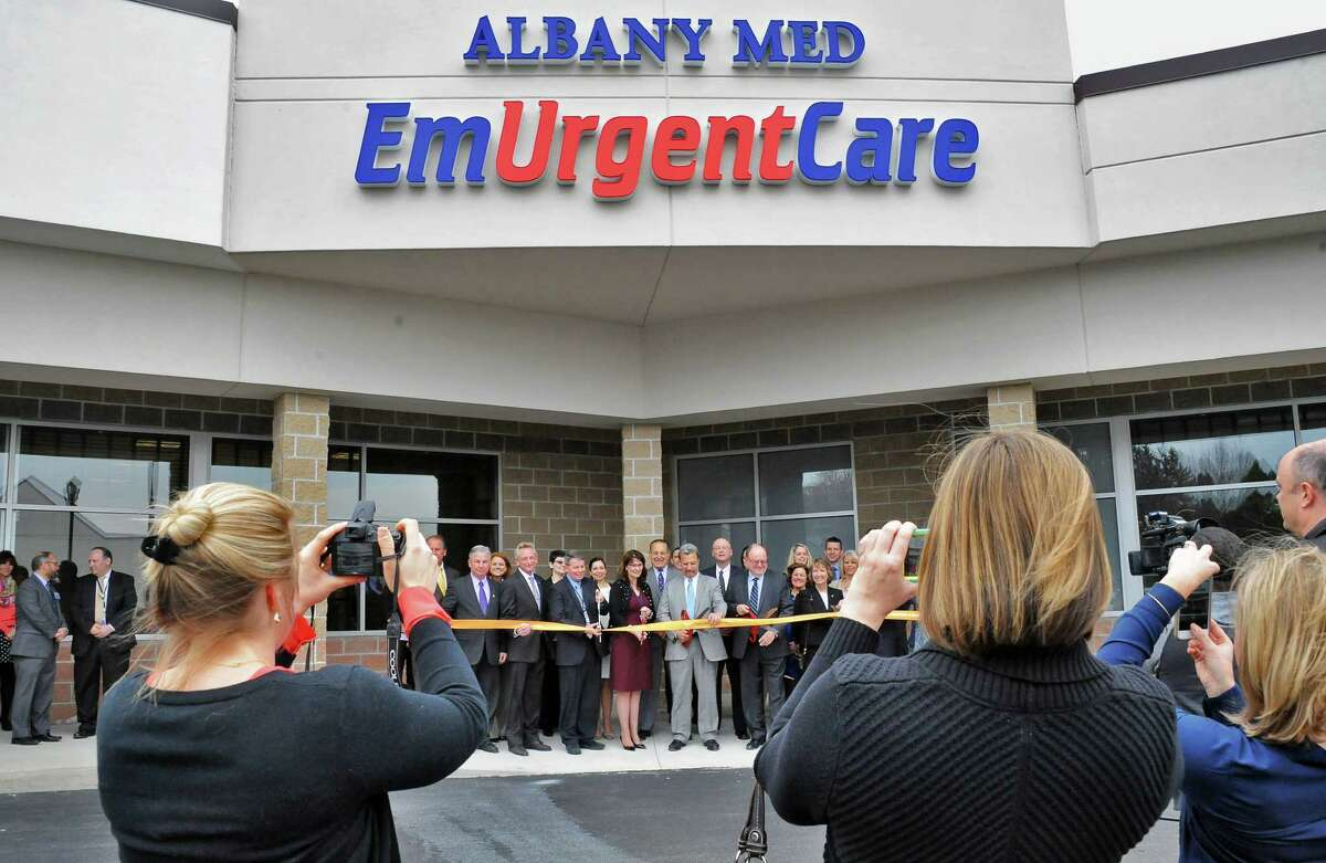 Dignitaries participate in a ribbon cutting & completion celebration for Albany Med's new EmUrgentCare facility Thursday March 31, 2016 in Brunswick, NY. (John Carl D'Annibale / Times Union)