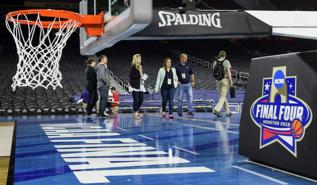 Officials work courtside while preparing NRG Stadium for the NCAA Final Four on Tuesday, March 29, 2016, in Houston. NRG Stadium will host the Final Four April 2-4. ( Brett Coomer / Houston Chronicle )