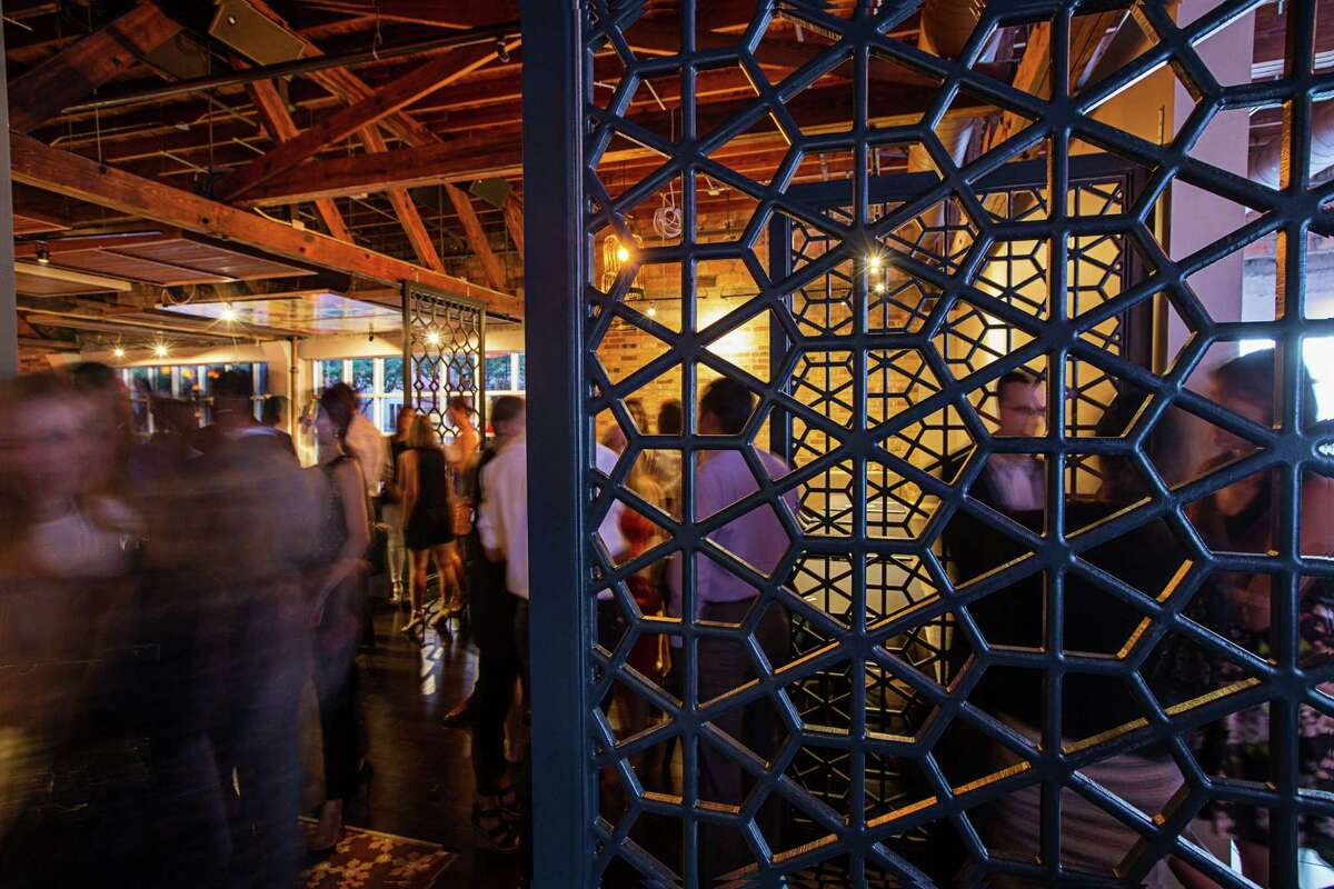 The evening crowd at Tarakaan, a new restaurant and lounge in Midtown at 2301 Main at Hadley. The much-anticipated venue features a hip Asian design with a large Buddha sculpture framed by a candle-lit wall anchoring the main dining room, and a bar painted with geisha faces.