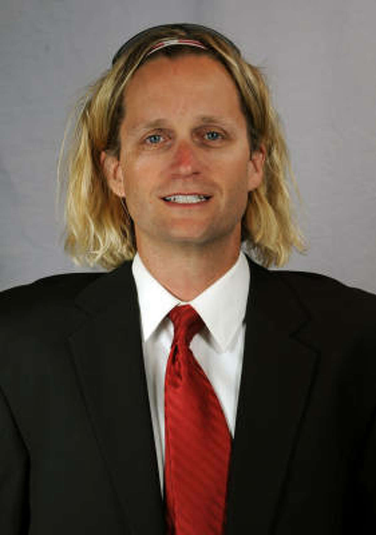 Oregon quarterbacks coach David Yost claims his hairstyle was crafted to set him apart in recruiting. It appears to have achieved his aim. (Oregon sports information department)
