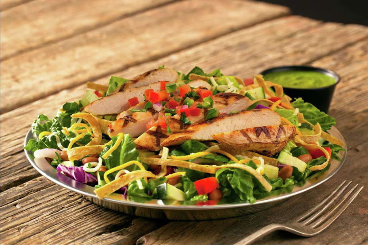 Cowboy Chicken features wood-fire rotisserie chicken along with salads and other menu items.
